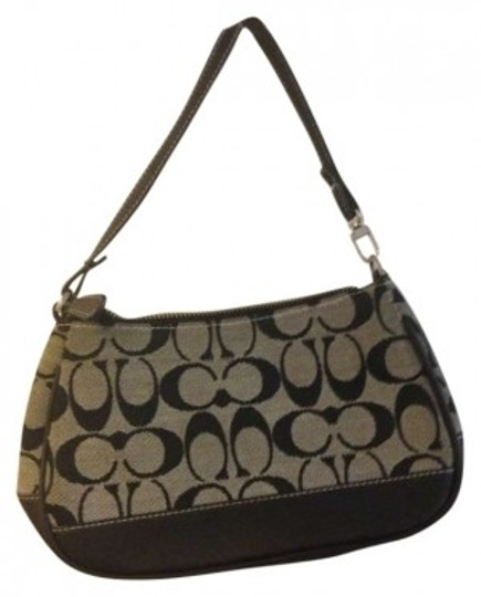 Preload https://item5.tradesy.com/images/coach-c-small-purse-black-baguette-150904-0-0.jpg?width=440&height=440