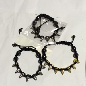 Independent Clothing Co. TRENDY SPIKED CONES ON MACRAME ADJUSTABLE CORD WITH HEMATITE BEADS