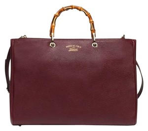 ae7ac6bd7 Added to Shopping Bag. Gucci Tote in Burgundy. Gucci Bag Bamboo Handle ...