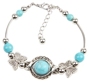 Brand New: Tibetan Silver butterfly charms, beads, Turquoise Beads Bracelet..
