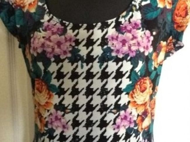 Fire short dress Black, White and Floral on Tradesy