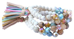 New One Ivory Stone Stretch Bracelet Faux Suede Multi Color Tassel