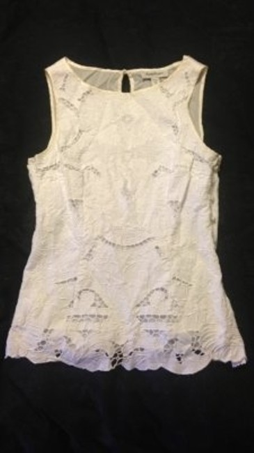 Preload https://item4.tradesy.com/images/bebe-white-tank-topcami-size-8-m-151368-0-0.jpg?width=400&height=650