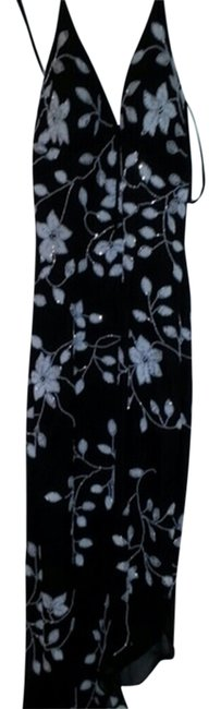 Preload https://item4.tradesy.com/images/cache-black-with-white-beaded-details-eveningcocktail-asymmetrical-hem-high-low-cocktail-dress-size--1513843-0-0.jpg?width=400&height=650