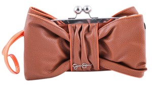 Jessica Simpson Brown Bow Clutch Wristlet in Tan