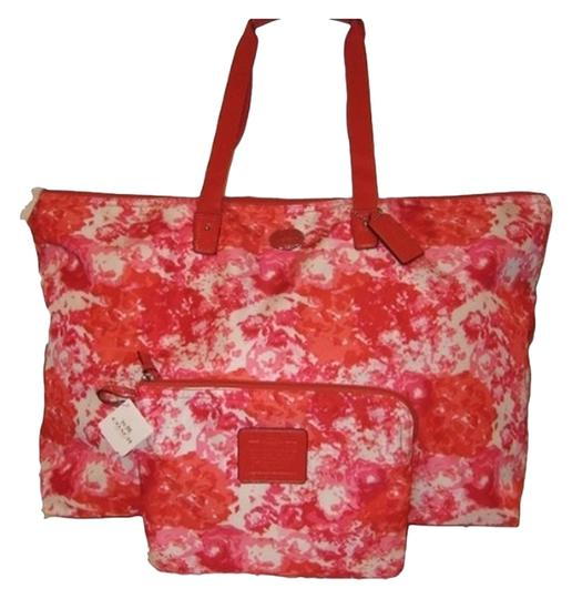 Preload https://item4.tradesy.com/images/coach-bnwt-f31441-diaper-set-pink-multi-floral-nylon-weekendtravel-bag-1516063-0-0.jpg?width=440&height=440