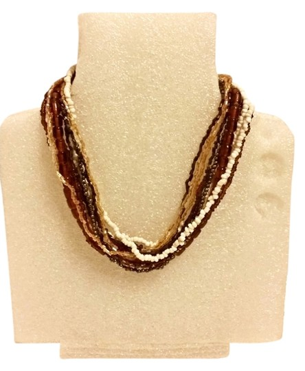 Preload https://item1.tradesy.com/images/multi-shades-of-brown-and-white-beaded-costume-necklace-1516580-0-0.jpg?width=440&height=440