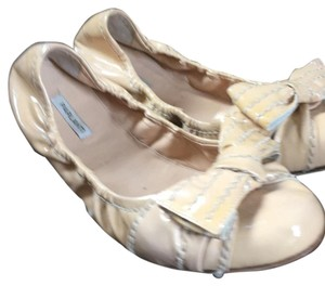 Made and bought in Florence Italy Nude color, patent leather flats, similar to Prada Worn twice Size 38.5 (8.5) Very gently used Flats