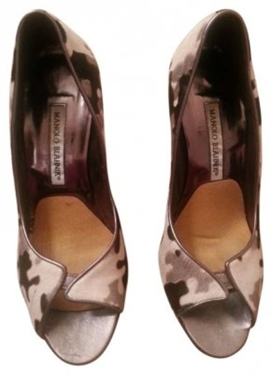 Preload https://item2.tradesy.com/images/manolo-blahnik-black-and-white-pumps-size-us-65-151701-0-0.jpg?width=440&height=440