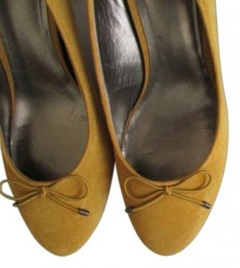 Preload https://img-static.tradesy.com/item/151890/ann-taylor-loft-mustard-yellow-classic-round-toe-w-bow-in-pumps-size-us-85-0-0-540-540.jpg