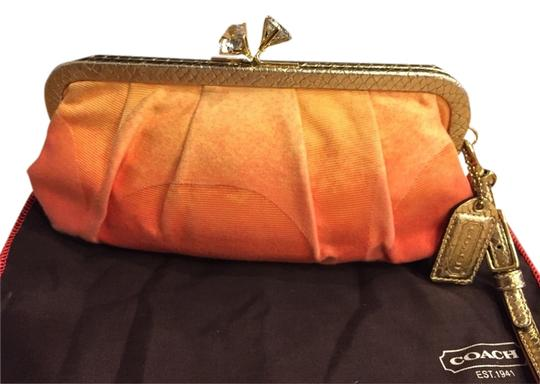 Preload https://item4.tradesy.com/images/coach-reduced-coach-signature-ombr-orange-clutch-1521098-0-0.jpg?width=440&height=440
