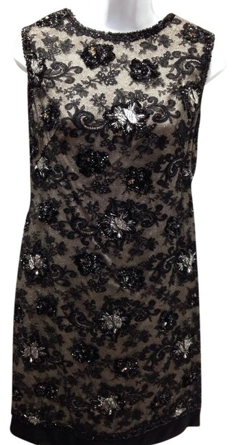 Preload https://item1.tradesy.com/images/black-lace-and-sequins-vintage-xs-above-knee-cocktail-dress-size-4-s-1521130-0-0.jpg?width=400&height=650