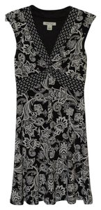White House | Black Market short dress Black V-neck Cap Sleeve And Floral Knot on Tradesy
