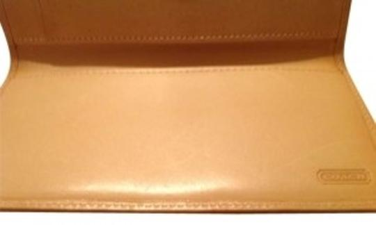 Preload https://item4.tradesy.com/images/coach-tan-and-brown-checkbook-wallet-152303-0-0.jpg?width=440&height=440