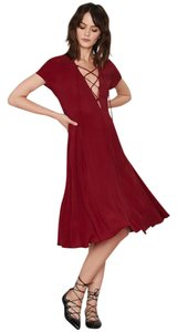 Nasty Gal short dress Burgundy Red Lace Up on Tradesy