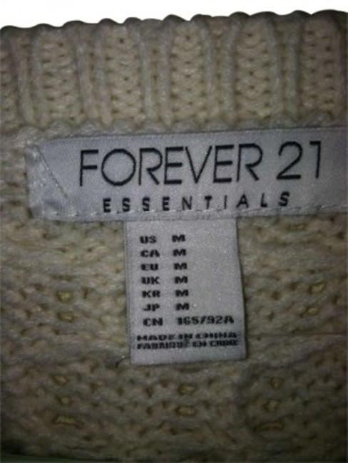 Preload https://item2.tradesy.com/images/forever-21-cream-colored-sweaterpullover-size-8-m-152571-0-0.jpg?width=400&height=650