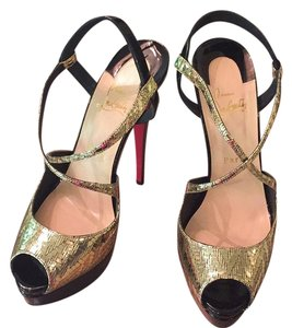 Christian Louboutin Gold and black Platforms