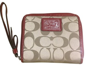Coach Wristlet in Tan And Dark Red