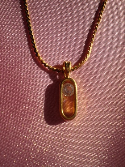 Unknown goldtone floating solitaire necklace