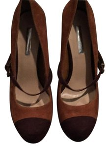 Halston Dark brown and Cognac suede. Platform and heel are wood. Platforms