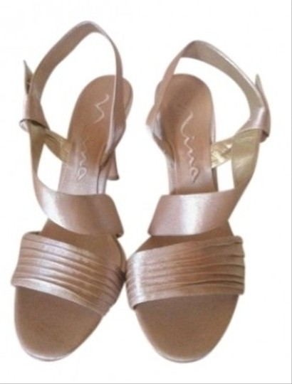 Preload https://item5.tradesy.com/images/nina-shoes-gold-gesalyn-strappy-sandal-leather-satin-like-new-pumps-size-us-10-153139-0-0.jpg?width=440&height=440