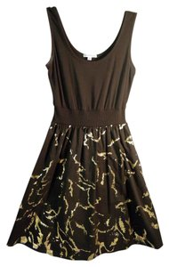 Velvet Torch short dress black & gold Tank on Tradesy