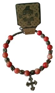 coral and silver beaded bracelet with cross charm