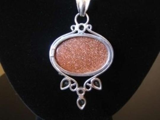 unknown Sterling silver pendant with gem stones