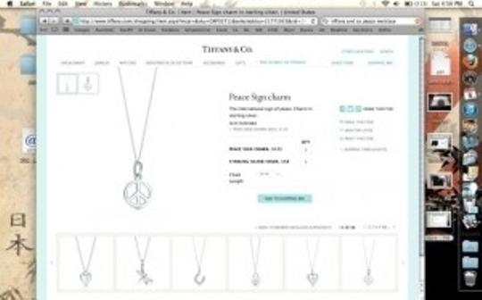 Tiffany & Co. Peace Charm Necklace 18 in chain