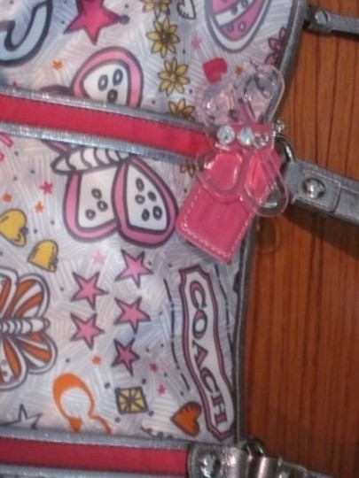 Coach Name: Pink Butterfly Description: Background With Butterflies Hearts Stars Flowers Logos. Shoulder Bag