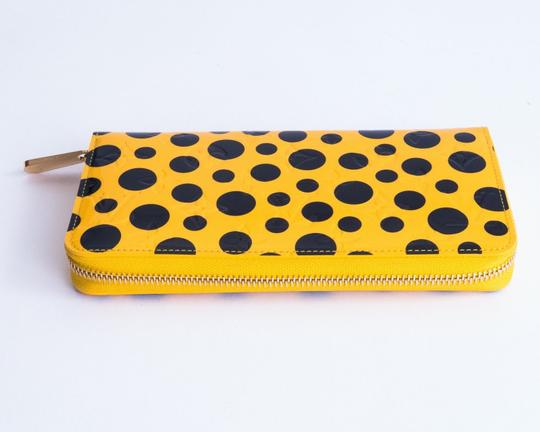 """Louis Vuitton Authentic Louis Vuitton Limited Edition """" Yayoi Kusama """"Vernis Dots zippy wallet in yellow"""