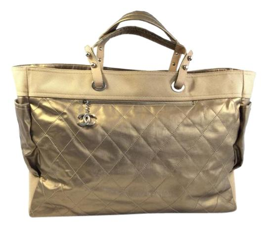 Preload https://item3.tradesy.com/images/chanel-extra-large-champagne-leather-and-canvas-tote-1539332-0-2.jpg?width=440&height=440