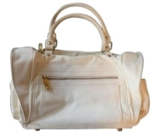 Preload https://item2.tradesy.com/images/rebecca-minkoff-matinee-off-duffel-style-creamwhite-leather-with-patent-shoulder-bag-153966-0-0.jpg?width=440&height=440