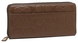Coach COACH F74529 Tobacco signature embossed accordion wallet mens zip around wallet MSRP $248