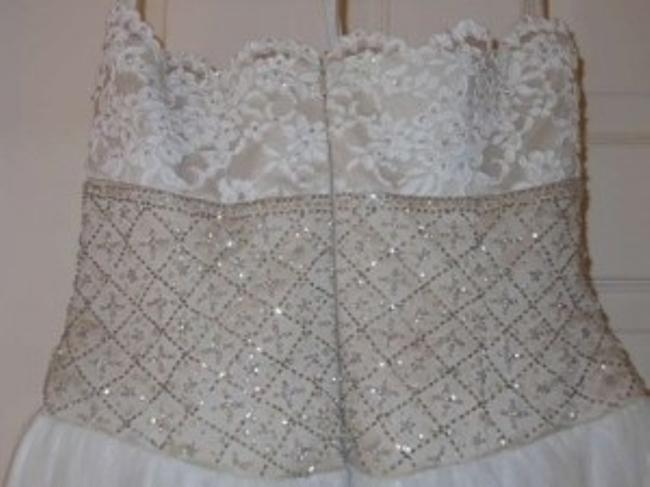David's Bridal Name: Strapless Beaded Gown Description: Gown With Full Bottom Beading On Waist 7 Lace Bust. Dress