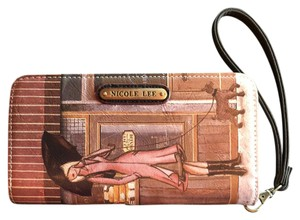 Nicole Lee print with multicolored with browns & tans. Clutch