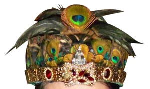 Hand made crown with many feathers and vintage costume jewelry.. Is wearable or just for display