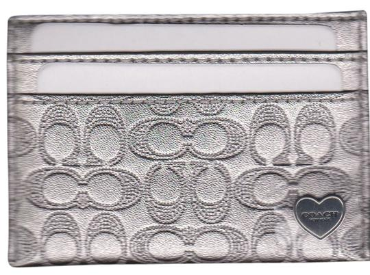 Preload https://img-static.tradesy.com/item/1545722/coach-silver-metallic-liquid-gloss-embossed-card-case-0-0-540-540.jpg