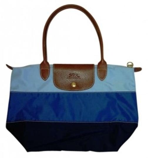 Preload https://img-static.tradesy.com/item/154640/longchamp-le-pilage-nylonleather-in-tricolor-navyroyallt-blue-nylonleather-tote-0-0-540-540.jpg
