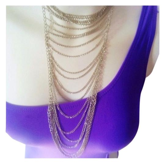 unsure Love this adjustable Silver multi layered chain drape necklace.