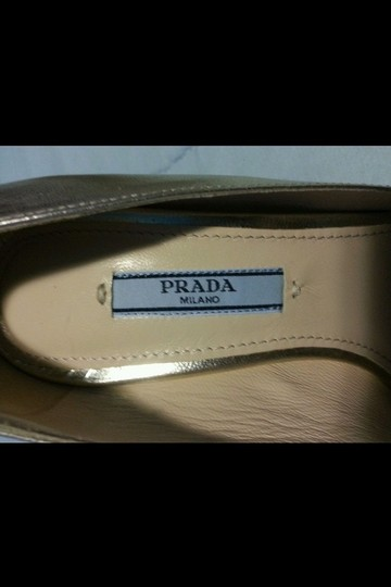 Prada Gold Pumps