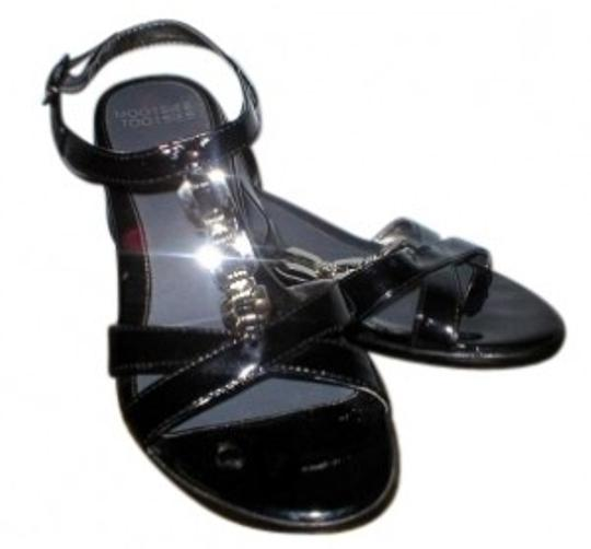 Preload https://item5.tradesy.com/images/mootsies-tootsies-black-sandals-size-us-75-155124-0-0.jpg?width=440&height=440