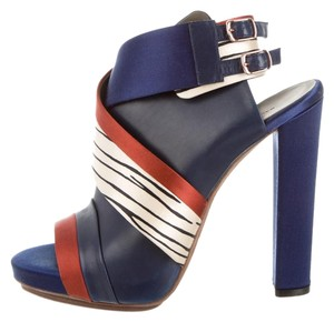 Balenciaga Blue and multicolor satin Balenciaga sandals with ornate print throughout, covered heels and buckle closures at ankles Sandals