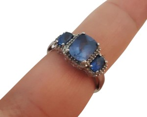 Blue Sapphire created ring in 10K white gold. Elegant Blue Sapphire ring