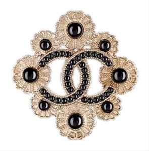 Chanel metal and fantasy Golden Pearly Black 16 A Brooch Cc Logo