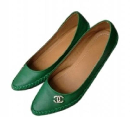 Preload https://item1.tradesy.com/images/emerald-green-faux-leather-casual-rhinestone-decor-on-side-flats-size-us-7-155585-0-0.jpg?width=440&height=440