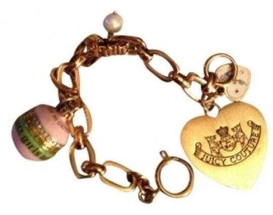 Preload https://item5.tradesy.com/images/juicy-couture-gold-tone-with-pinkgreen-ornament-charm-bracelet-15564-0-0.jpg?width=440&height=440