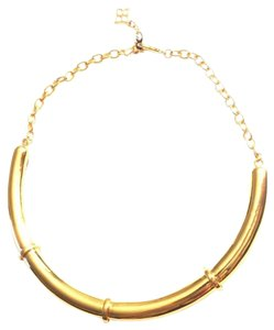 BCBGMAXAZRIA Gold colored crescent necklace by BCBG MAX AZRIA