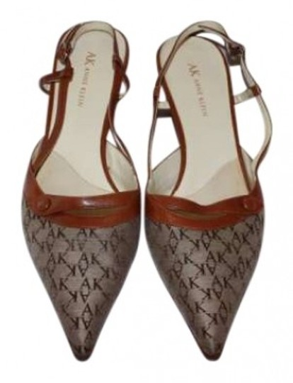 Preload https://img-static.tradesy.com/item/155831/anne-klein-signature-ak-with-brown-leather-trim-pumps-size-us-10-0-0-540-540.jpg