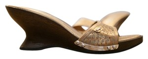 Salvatore Ferragamo Exotic Gold, metal hardware accents, and wood Mules